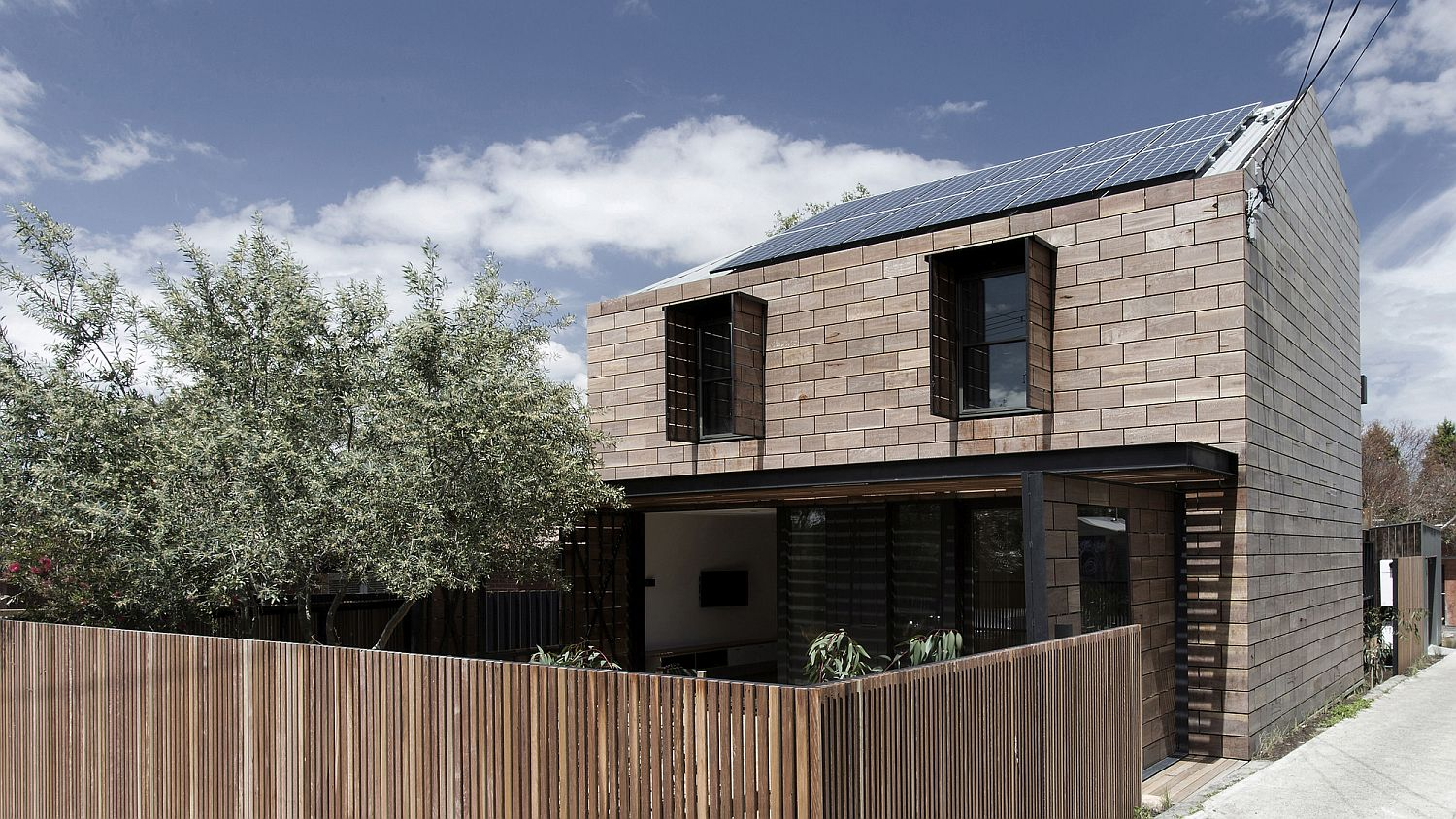 Adaptable street facade of the home with operable blinds