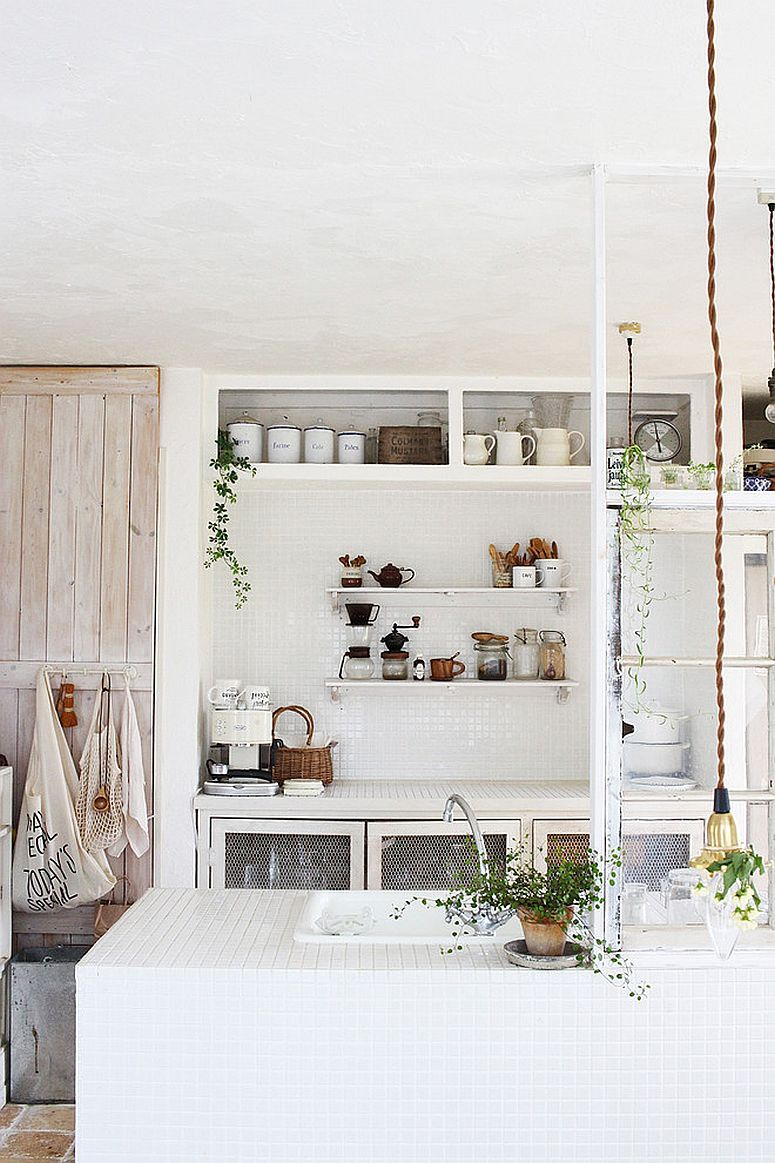 All-white shabby chic kitchen with plenty of natural greenery