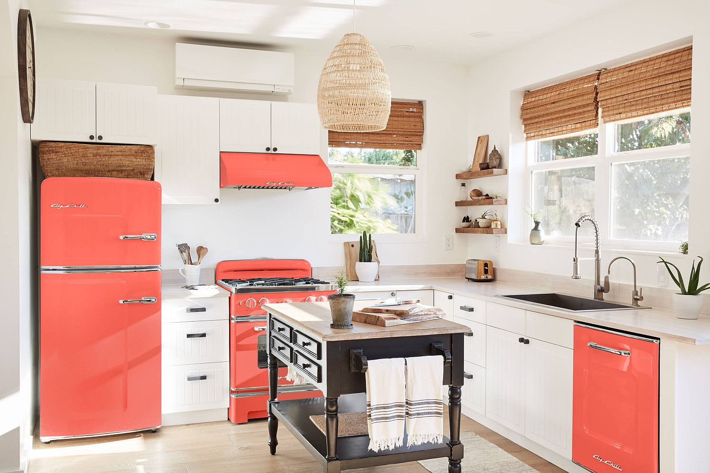 Appliances-bring-orange-to-this-kitchen-in-white