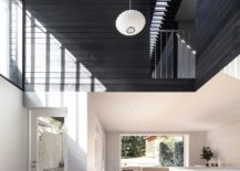 Black-and-white-living-area-with-lighting-that-is-understated-217x155