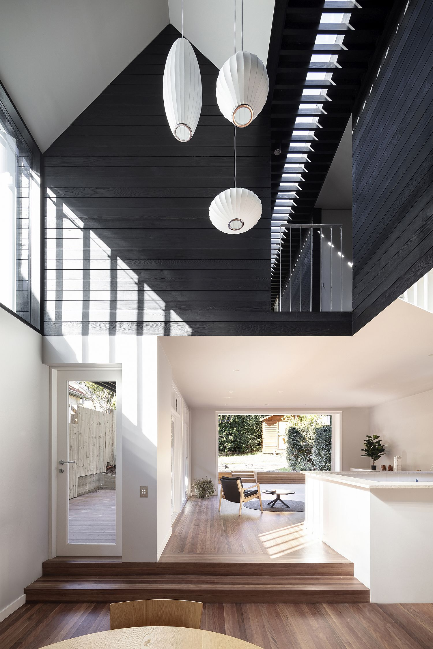 Black-and-white-living-area-with-lighting-that-is-understated