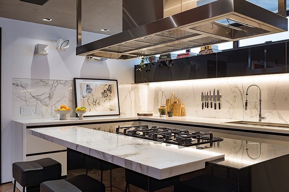 Brilliant-blend-of-polished-black-and-white-stone-finishes-in-the-kitchen