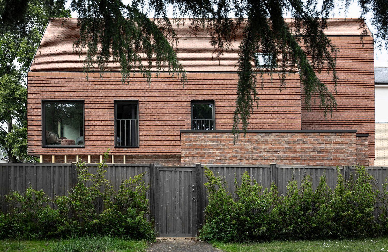 Custom terracotta tiles shape the facade of the London home
