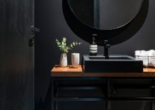 Dark-and-dashing-powder-room-in-black-is-a-showstopper-217x155