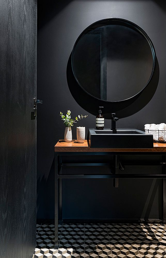Dark-and-dashing-powder-room-in-black-is-a-showstopper