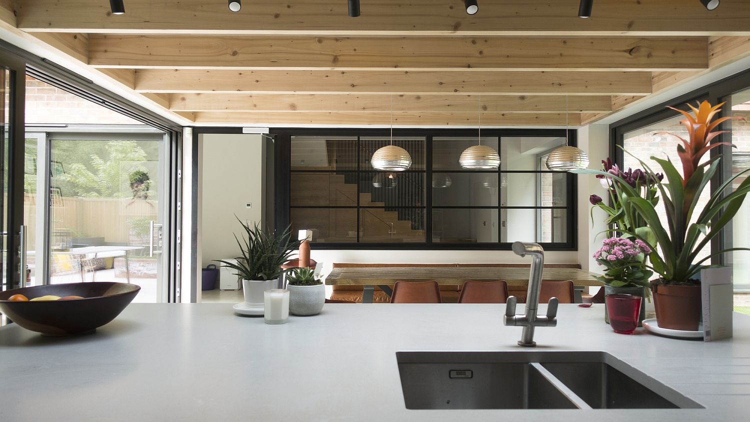 Dashing modern wood and white kitchen with gray accents