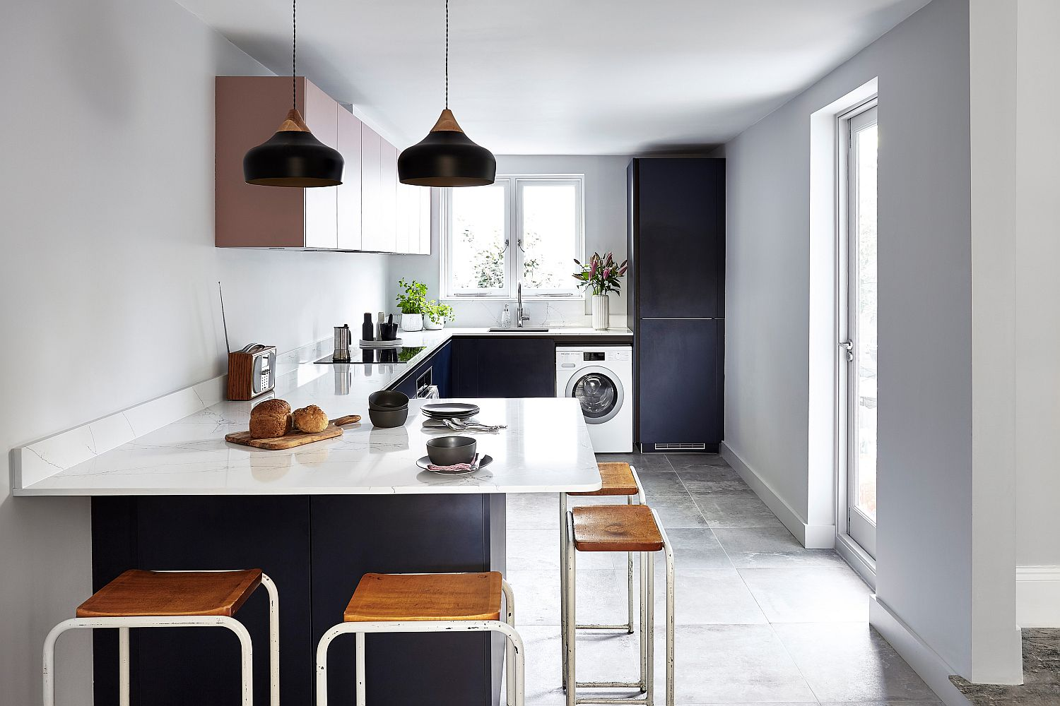 Delightful black pendants stand out visually when placed against the light, neutral backdrop