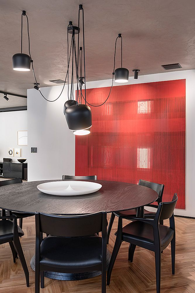 Dining-room-with-a-hint-of-red-and-stylish-contemporary-lighting