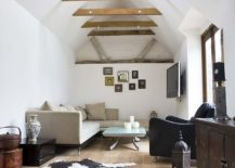 Double-height-living-room-of-London-home-with-innovative-use-of-ceiling-beams-217x155
