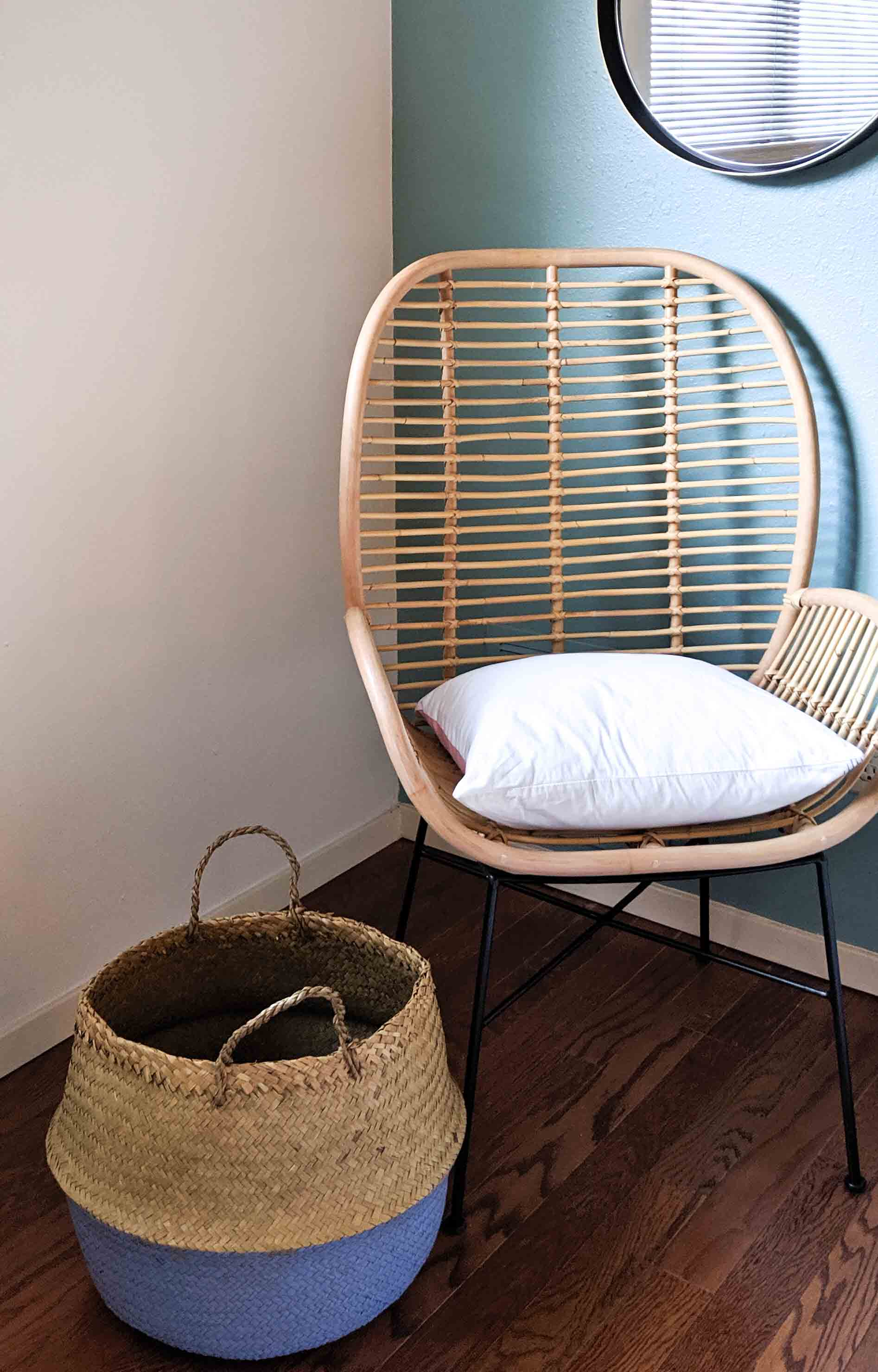 Earthy basket paired with a rattan chair