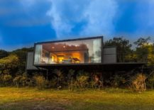 Elevated-design-o-the-cabin-overlooks-the-forest-and-green-landscape-outside-217x155