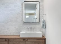 Floating-brick-vanity-for-the-modern-bathroom-in-white-and-gray-217x155