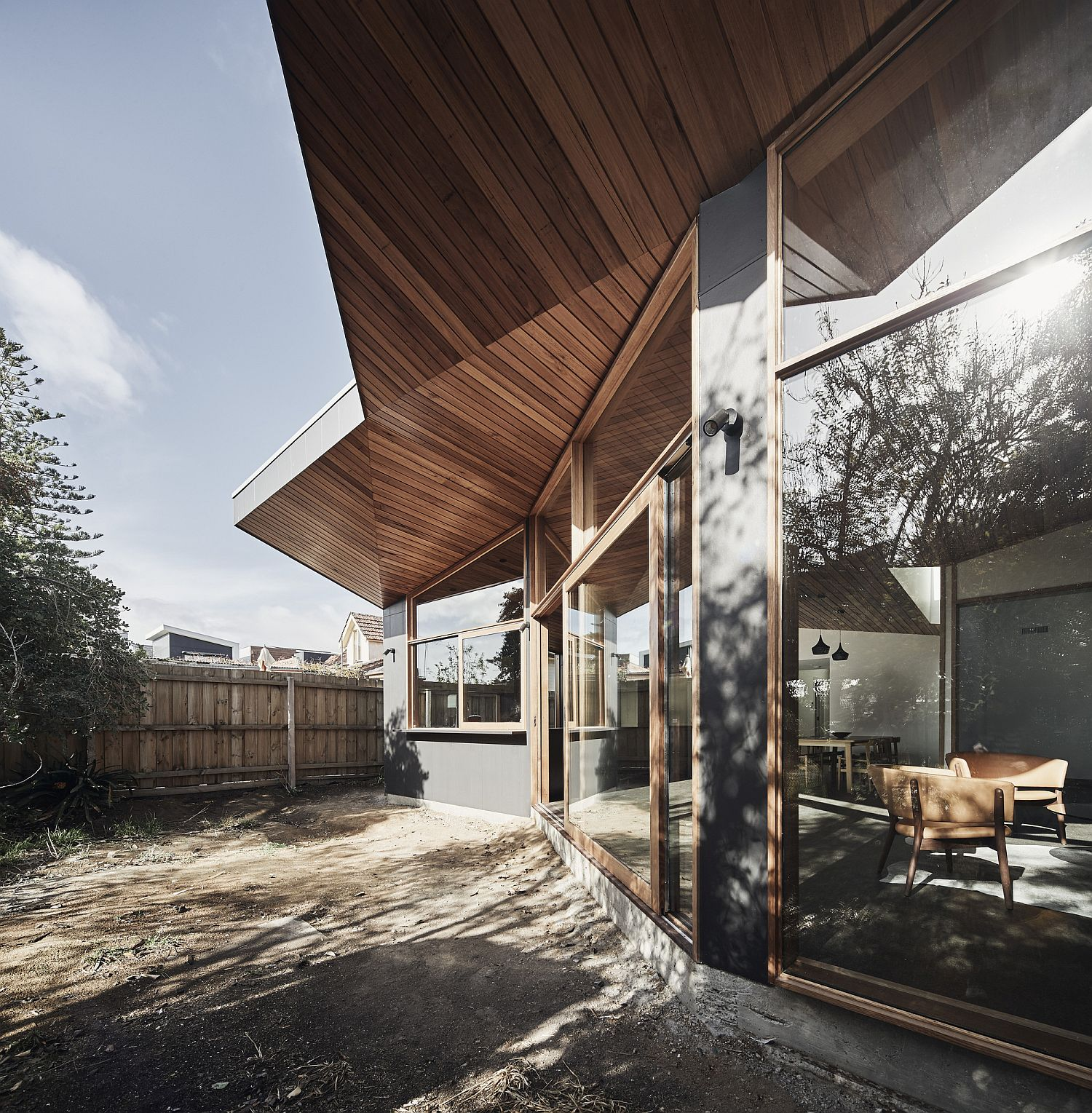 Folded wooden ceiling design of the modern extended AUssie home