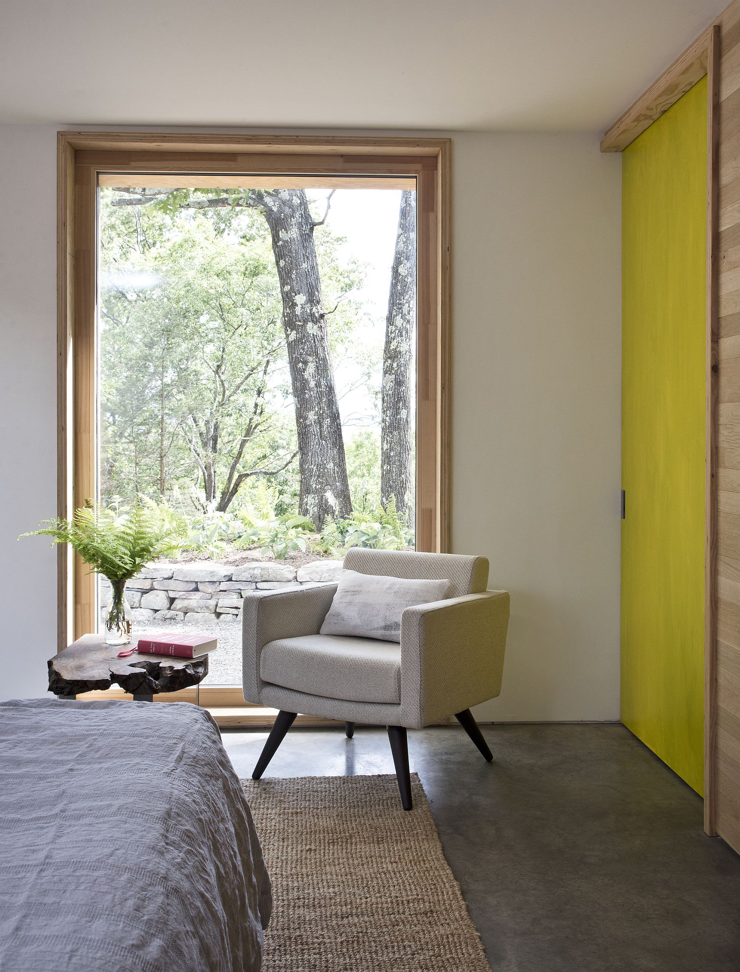 Glass wall sections and windows bring in plenty of natural light