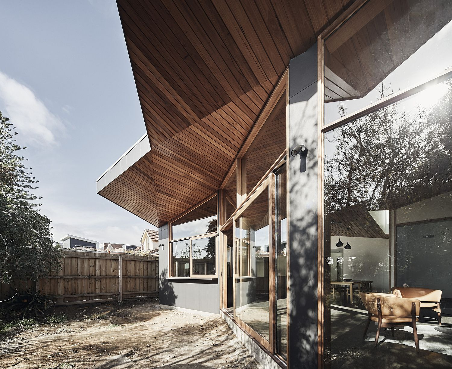 Glass, wood and stylish design elements create a gorgeous rear extension