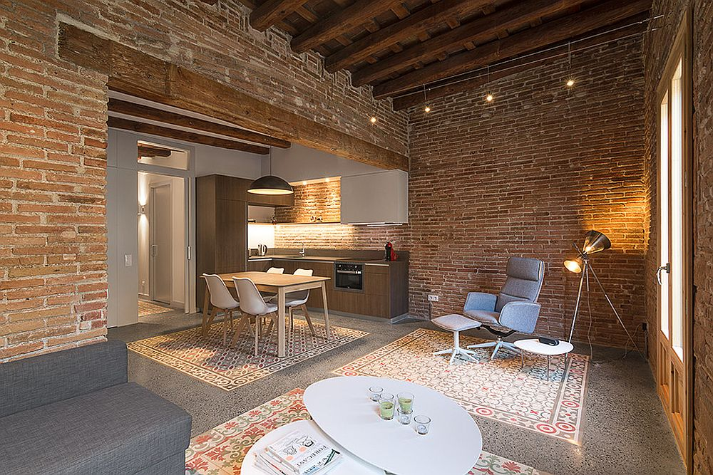 Industrial living room with brick walls and ceiling beams