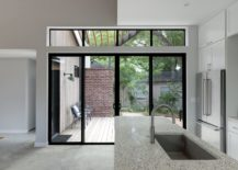 Kitchen-inside-the-house-connected-with-the-greenery-outside-217x155