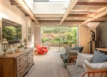 Makeover-of-abondoned-home-has-a-living-room-with-woodsy-ceiling-that-feels-cozy-217x155