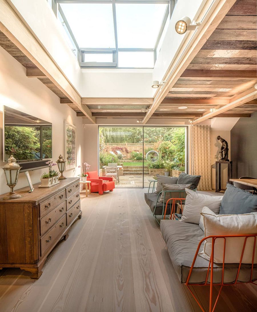 Makeover of abondoned home has a living room with woodsy ceiling that feels cozy