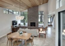 Open-plan-living-area-of-the-house-with-fireplace-at-its-heart-217x155