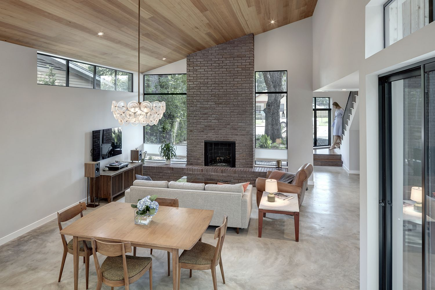 Open plan living area of the house with fireplace at its heart