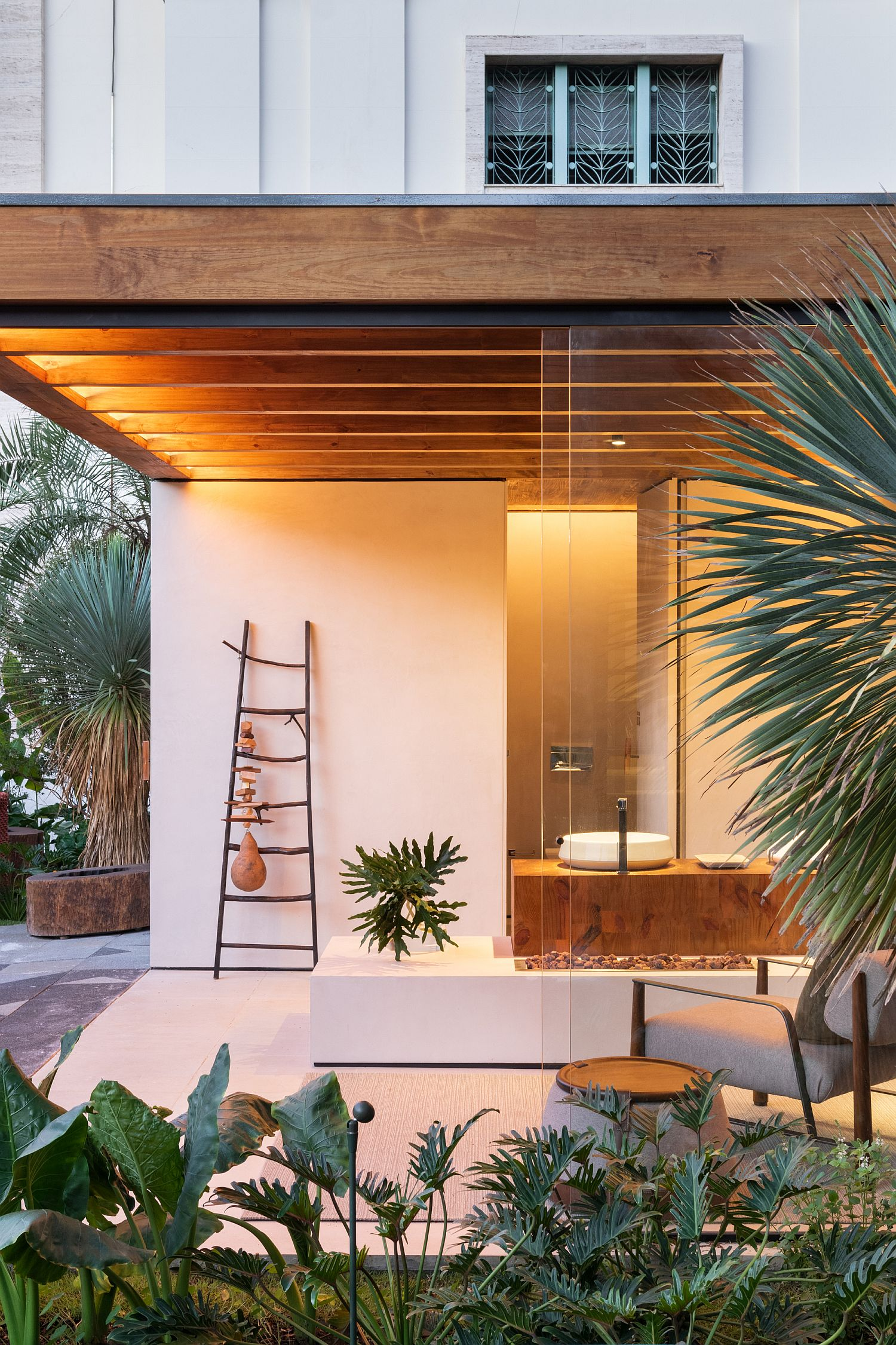 Pergola like structure of the terrace extends the living area into the garden