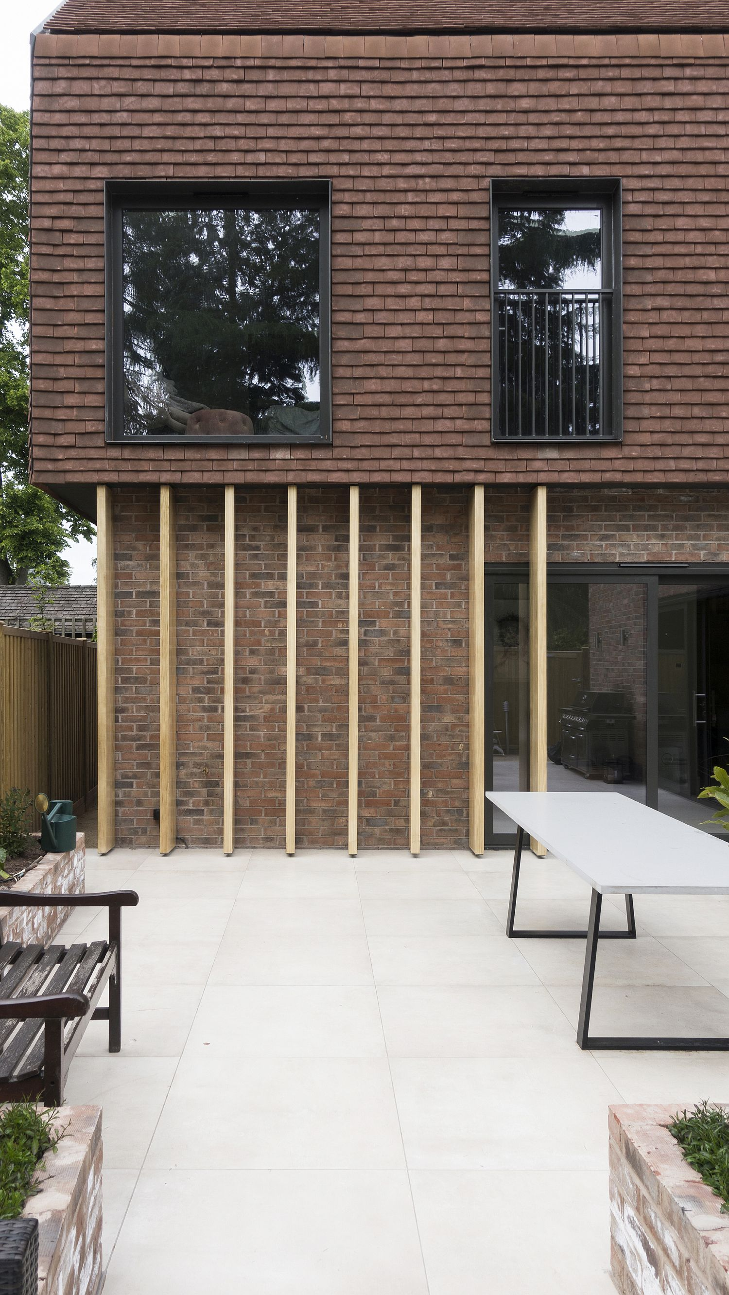 Pivate courtyard of the Terracotta House surrounded by greenery
