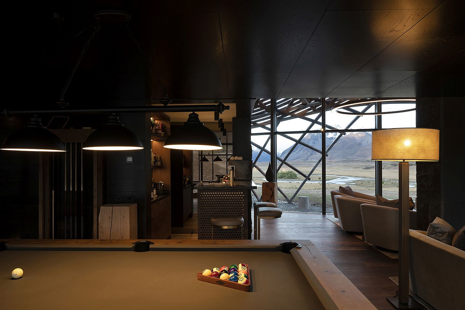 Pool table, bar and living area of the lodge