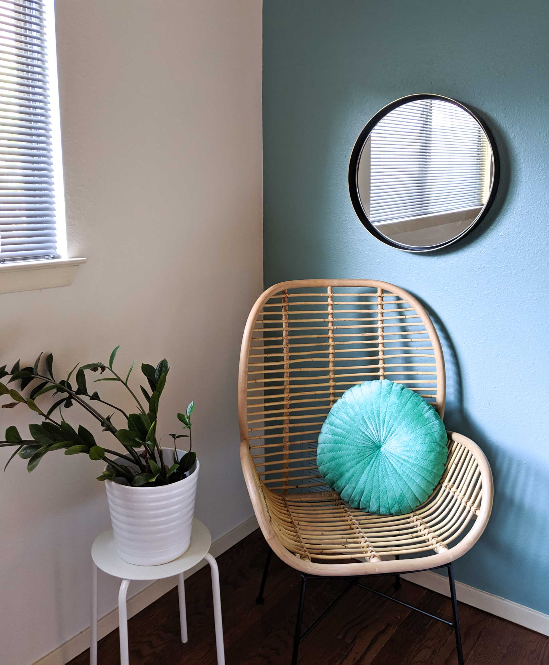 Rattan chair in a blue room