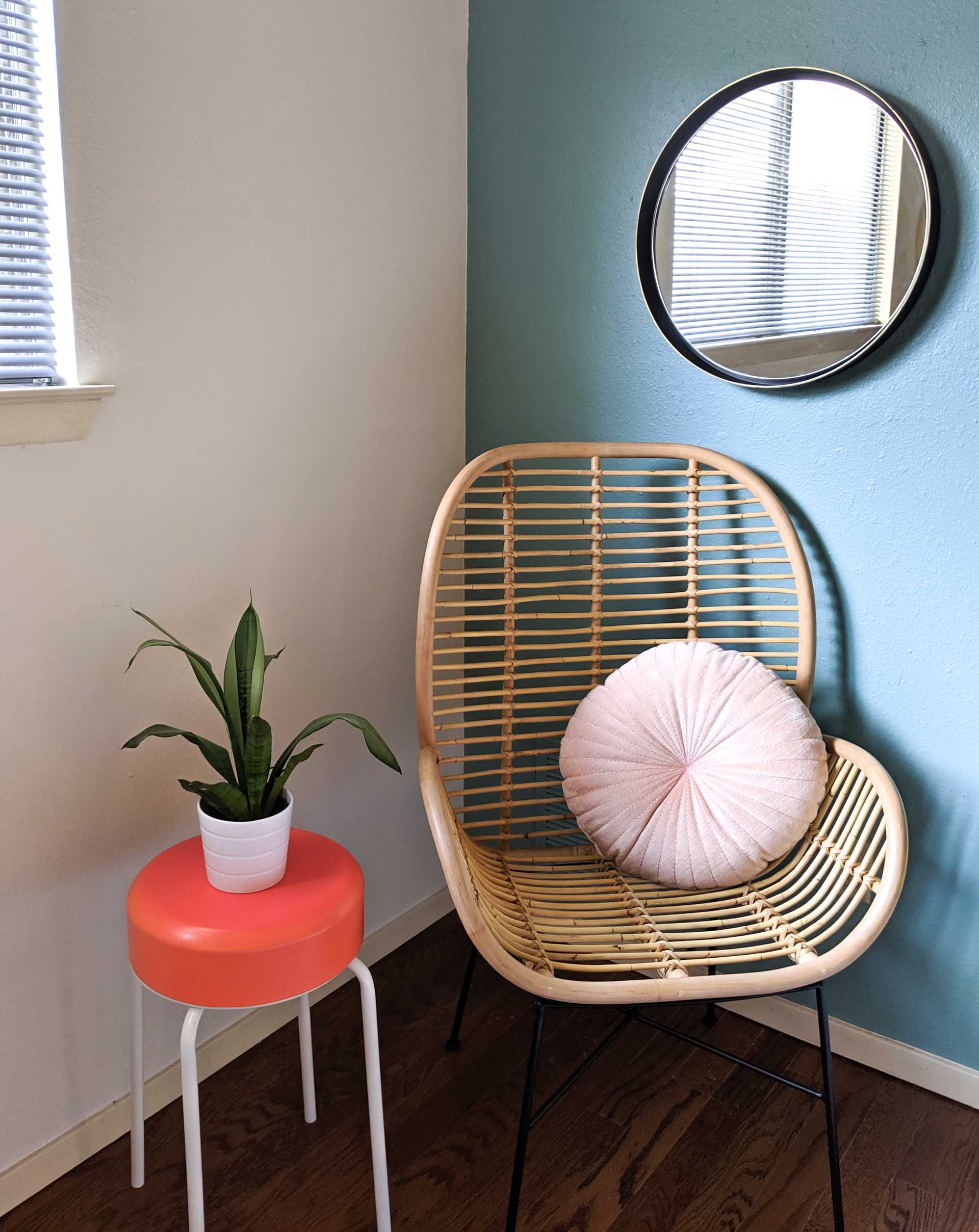 Rattan chair with a scalloped pillow