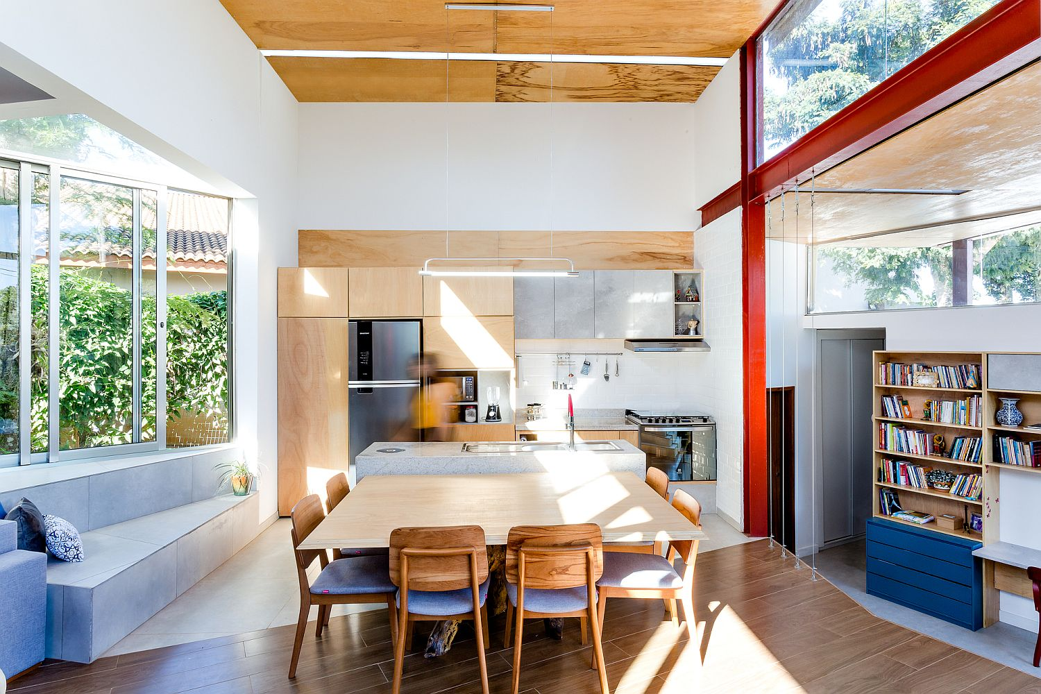 Red and blue accents add color to the neutral interior