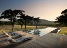 Relaxing-spacious-wooden-deck-and-pool-area-at-the-Mabote-House-217x155
