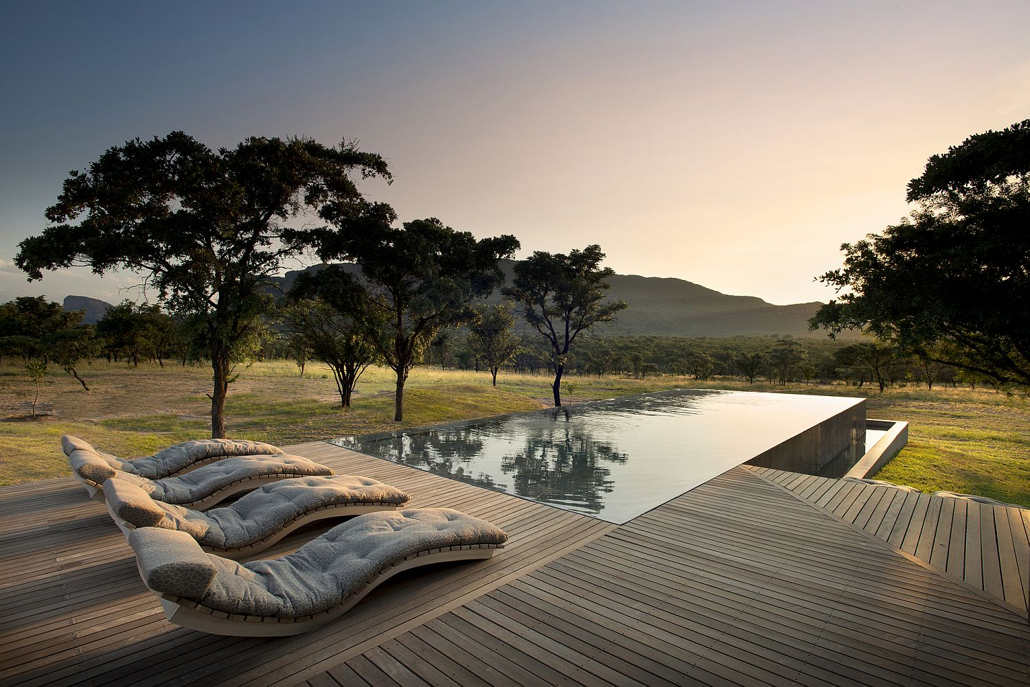 Relaxing-spacious-wooden-deck-and-pool-area-at-the-Mabote-House