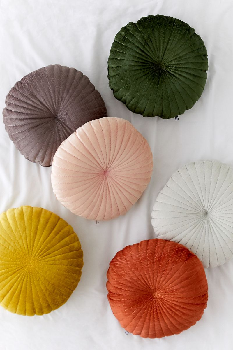 Round scalloped velvet pillows