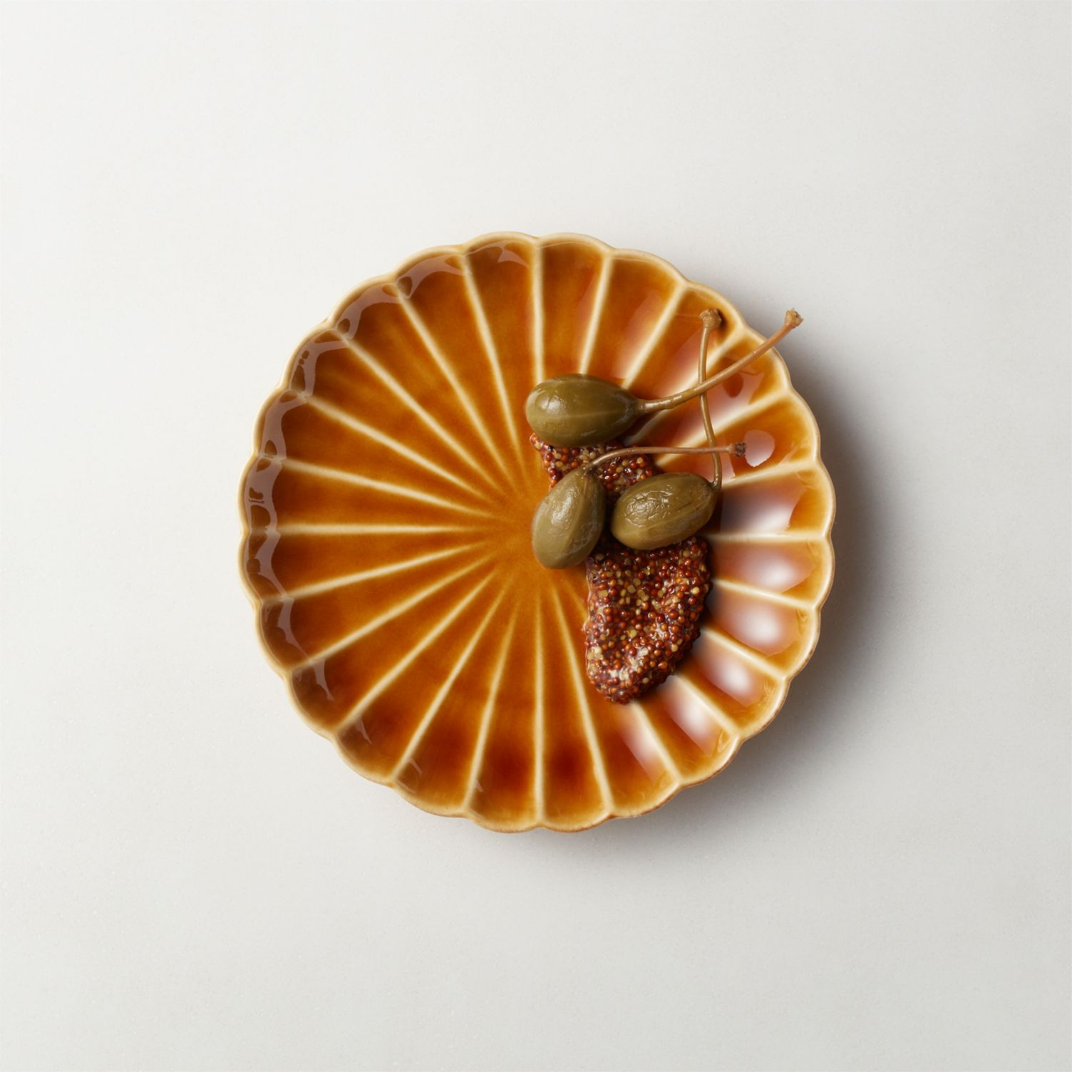 Scalloped appetizer plate in camel brown