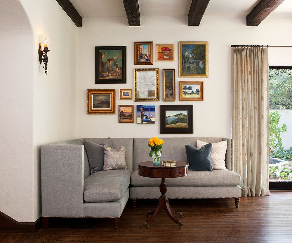 Small coastal chic living room with custom corner sofa and a gallery wall