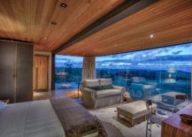 Smart-design-of-the-cabin-with-glass-walls-overlooks-the-landscape-outside-217x155