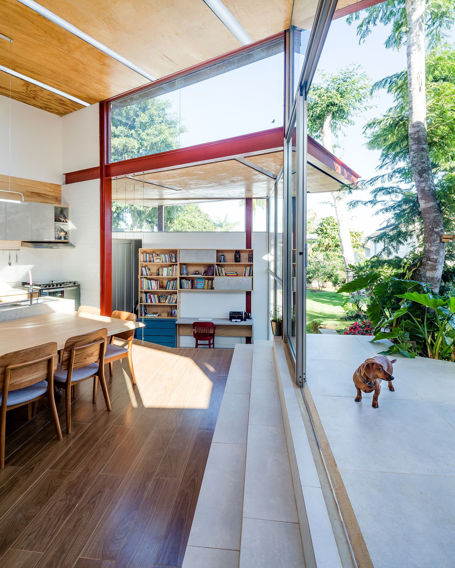 Smart use of sliding glass doors connects the living area with the deck