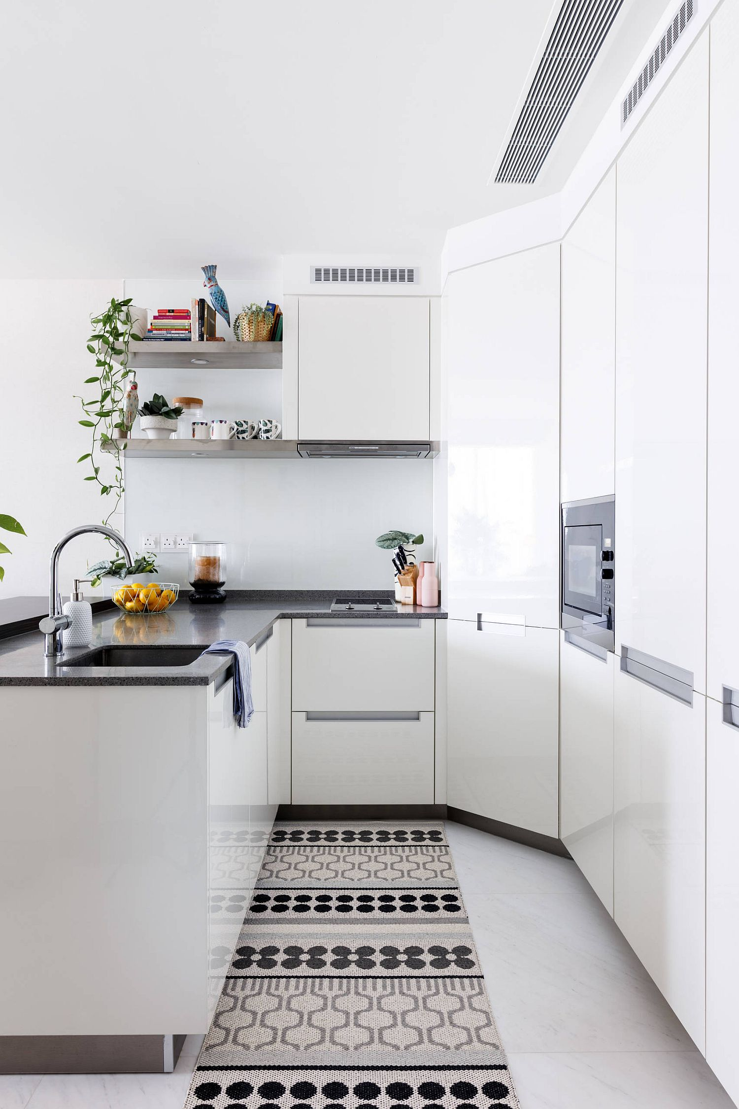 Space-savvy tiny kitchen in white with modern Scandinavian style