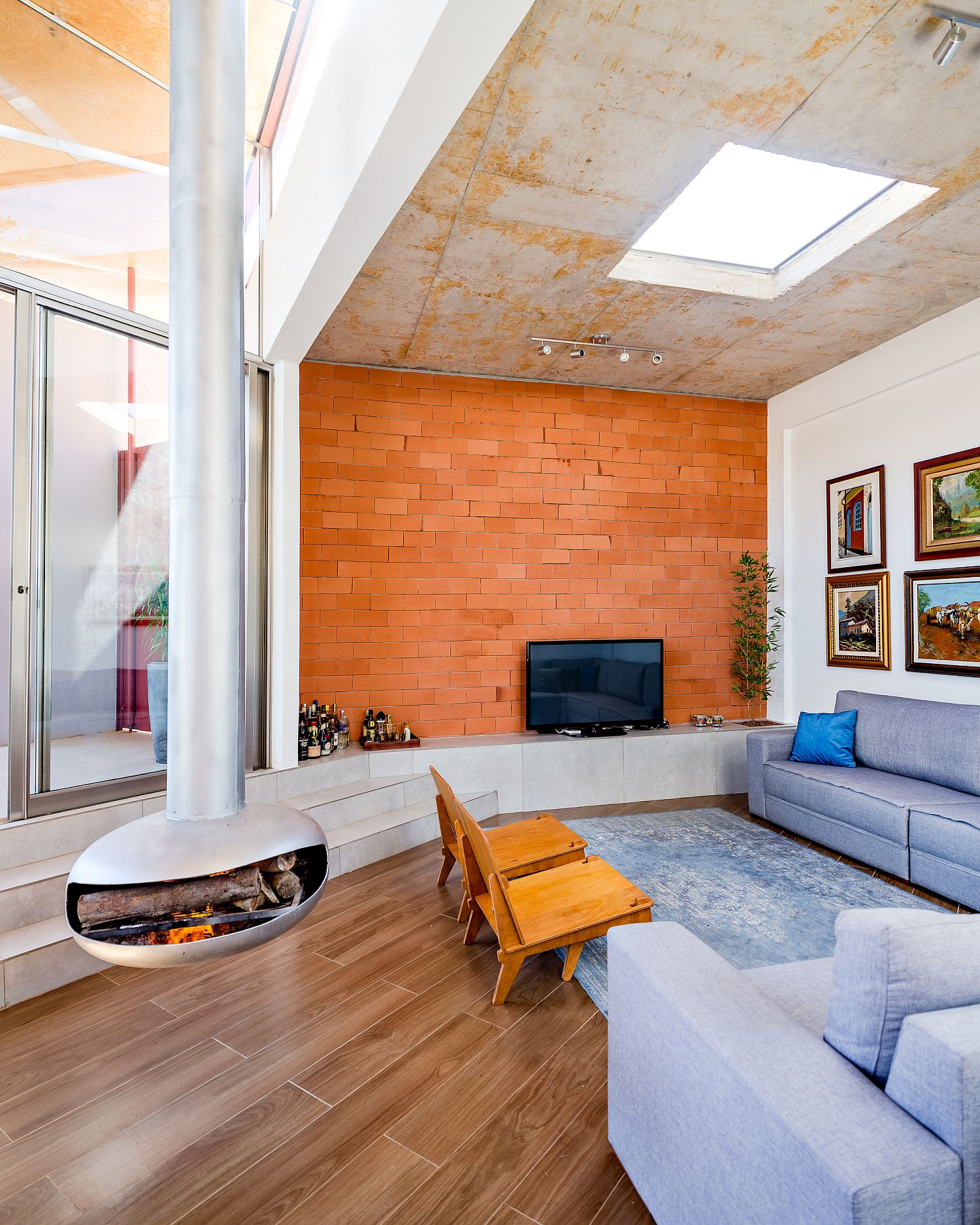 Tiled accent wall for the living area with skylight above