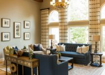 Traditional-living-room-with-wooden-ceiling-beams-and-bright-blue-sofas-217x155