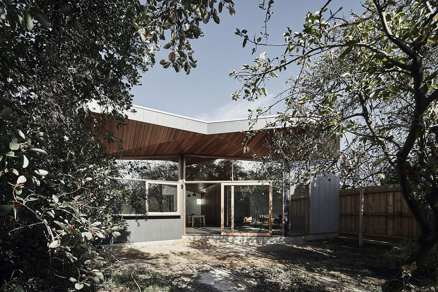 Trees offer shade to the exterior of the house