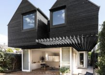 Two-overhanging-dark-wood-structures-extend-the-old-home-in-Australia-217x155