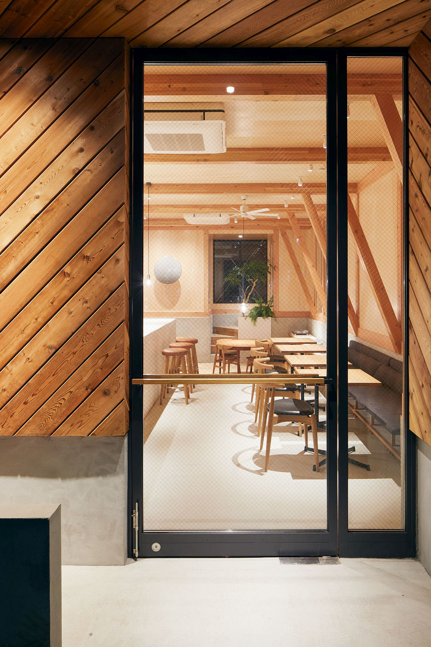 View-from-outside-of-the-cafe-shaped-in-wood-and-terrazo
