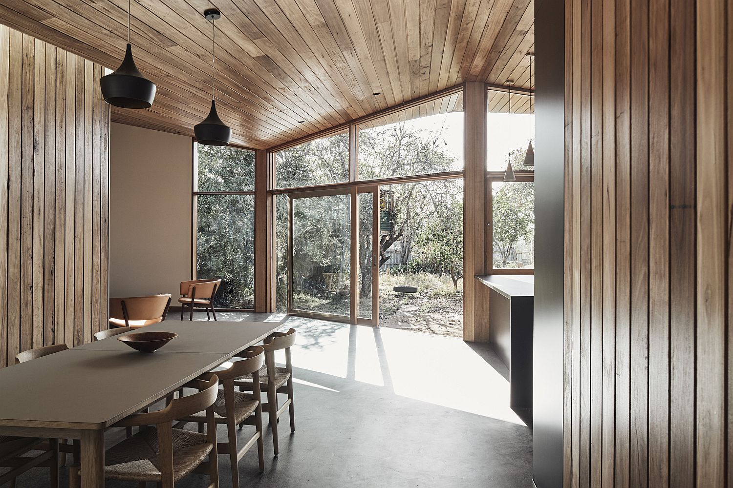 Walls and ceiling draped in wood adds warmth to the interior