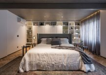 Walls-of-the-bedroom-provide-ample-storage-and-display-space-217x155
