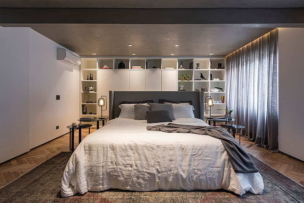 Walls-of-the-bedroom-provide-ample-storage-and-display-space
