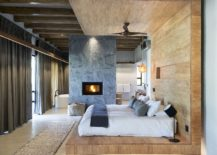 Wood-stone-and-natural-finishes-give-a-relaxing-vibe-to-the-spectacular-bedroom-here-217x155