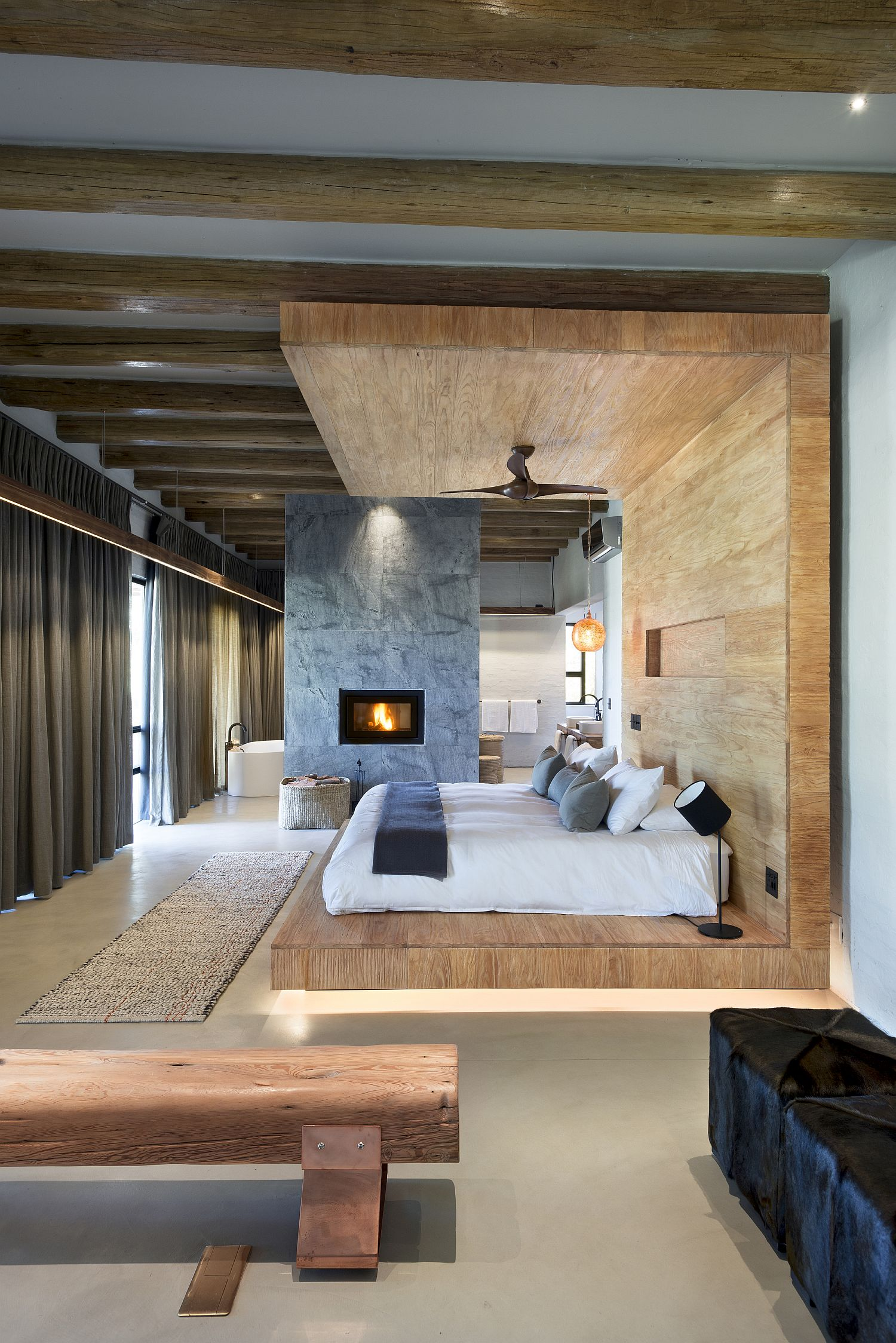 Wood-stone-and-natural-finishes-give-a-relaxing-vibe-to-the-spectacular-bedroom-here