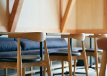 Wooden-stools-inside-the-cafe-add-to-its-minimal-Japanese-style-217x155